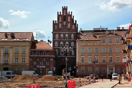Bartoszyce, Poland - May 6, 2019: View of main Constitution square with Lidzbark Gate in the center of Bartoszyce, Warmian-Masurian Voivodeship, Poland Editöryel