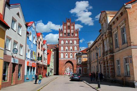 Bartoszyce, Poland - May 6, 2019: View of historical Lidzbark Gate on main Constitution square in the center of Bartoszyce, Warmian-Masurian Voivodeship Editöryel