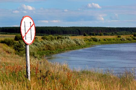 Navigational mark on a riverbank. Inland navigation helps ships and vessels find fairways and get through rivers and canals.