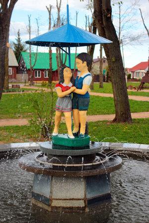 Przerosl, Poland - May 3, 2019: A fountain on central Market Square in Przerosl, a village in Suwalki County, Podlaskie Voivodeship, in north-eastern Poland. Editöryel