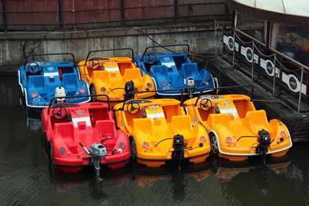 Gdansk, Poland - May 9, 2019: Colorful water taxi motorboats on Motlawa river in central Gdansk. Editöryel