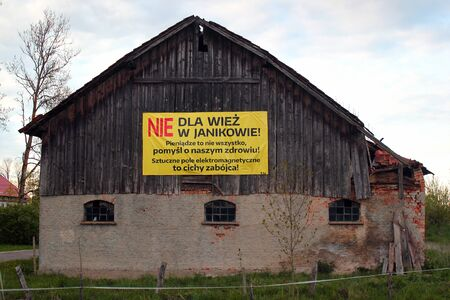 Janikowo, Poland - May 6, 2019: Protest poster against cellphone tower installation. It reads No to towers in Janikowo! Money isnt everything, think of our health! Electromagnetic field is a silent killer!