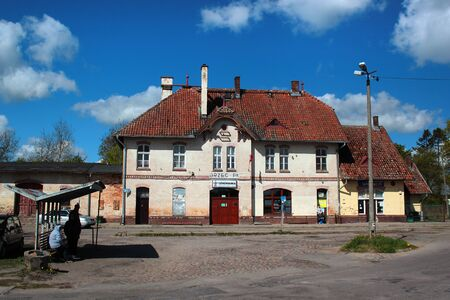 Gorowo Ilaweckie, Poland - May 7, 2019: Old railway station building and the bus stop in Gorowo Ilaweckie.