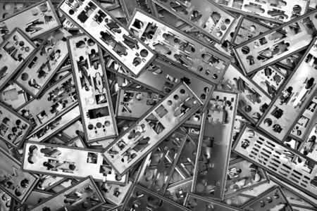 Pile of PC motherboard backplates. Computer technology background.