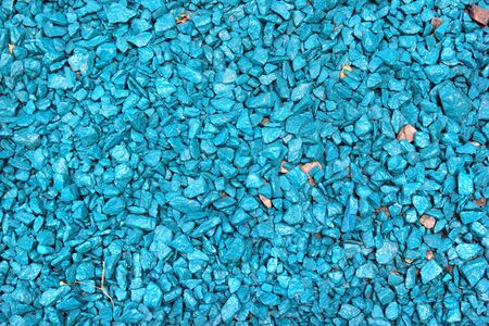 Blue painted gravel in a garden as background Banco de Imagens