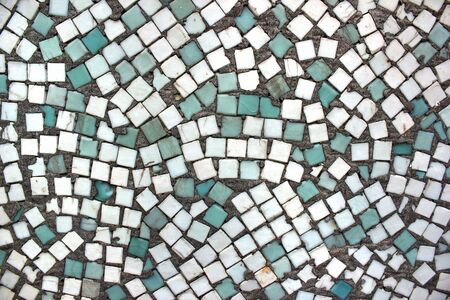 Cyan and white ceramic tiles in an abandoned swimming pool