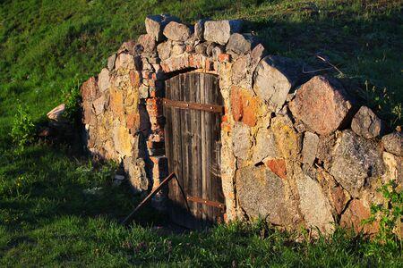 Root cellar door in a countryside, Poland