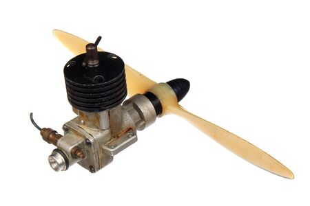Small aircraft model diesel engine with propeller, isolated against white background