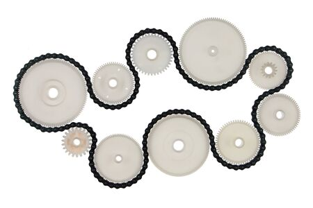 White plastic cogwheels and metal chain, isolated on white background. Transmission concept.