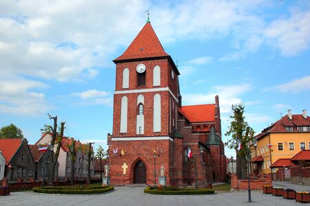Gothic Saint James church in central Tolkmicko, a town in northern Poland, on the Vistula Lagoon. Фото со стока