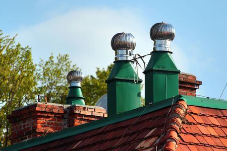 Revolving cowls eradicate downdraft in chimneys, flues and ducts Фото со стока