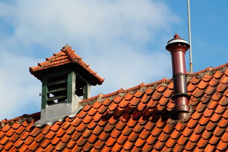 Ventilating chimneys on a rooftop