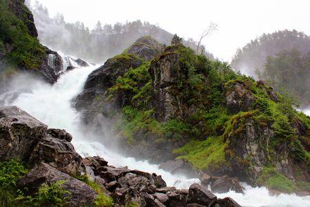 Latefoss waterfall in rainy weather, Norway Фото со стока