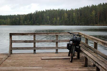 Touring bicycle on a riverside wooden platform