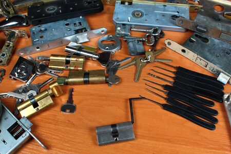 Locksmith workshop. Keys, locks and picklocks on table