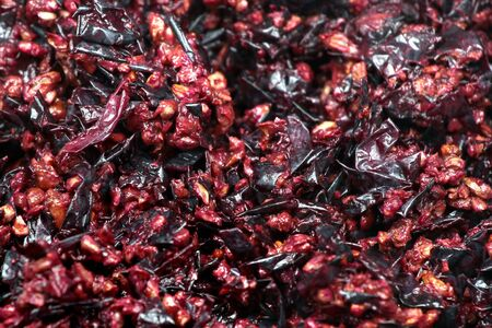 Pressed grape pomace, seeds and skins. Winemaking background.