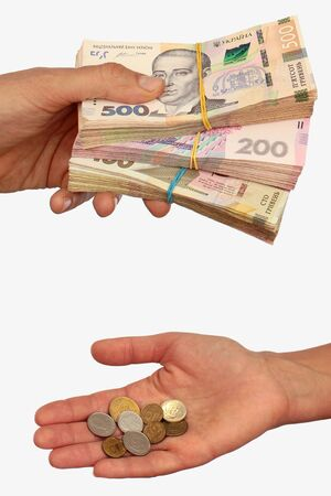 Rich man with banknotes and poor woman with coins. Income inequality concept. Hands hold hryvnia, the money of Ukraine. Isolated against white background.
