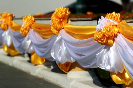 Decorative flowers made of yellow and white ribbons, traditional colors of Thailand