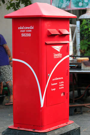Chiang Mai, Thailand - December 3, 2019: Mailboxes of Thailand Post traditionally have red color.