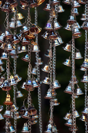 Chiang Mai, Thailand - December 3, 2019: Bells at Wat Phra Singh, a famous Buddhist temple in the old city center of Chiang Mai. Éditoriale
