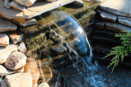 Small rockery with waterfall in a garden Banque d'images
