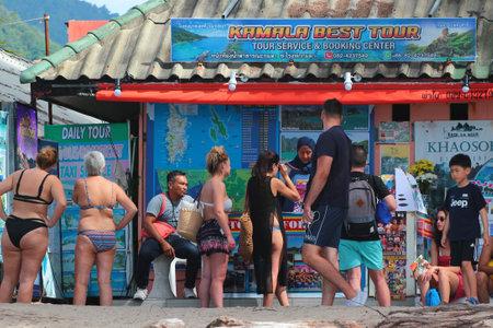 Phuket, Thailand - December 4, 2019: Tourists at the Kamala Beach, a popular place in Phuket island north of Patong city.
