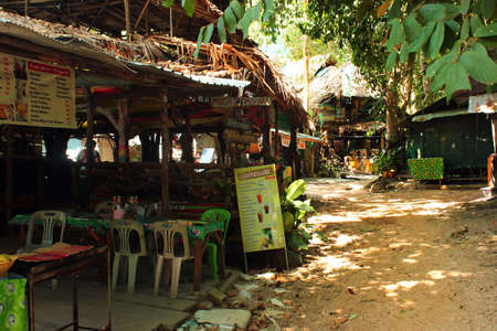 Tonsai, Thailand - December 8, 2019: Small shops, cafes and bars at Ton Sai Beach, a scenic and tranquil beach surrounded by trees and dramatic cliffs in Krabi province.