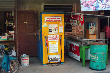 Phuket, Thailand - December 5, 2019: Self-service fuel dispenser at a small street shop. Such mini gas stations are ubiquitous in Phuket.