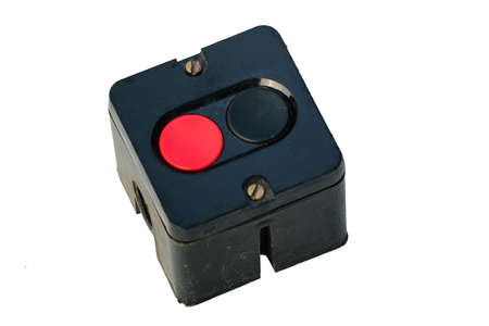 Old power switch with red and black buttons, isolated on white background