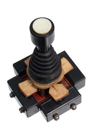 Old joystick made of four push buttons and a handle, isolated against white background Фото со стока
