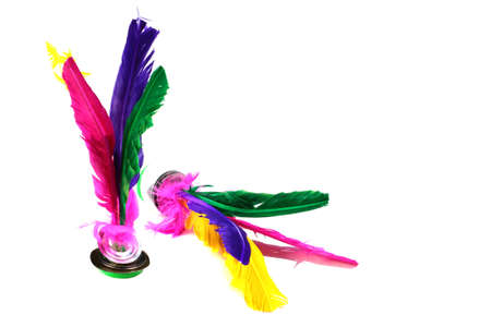 Jianzi, traditional Chinese shuttlecock with four feathers fixed into a rubber sole or plastic discs Фото со стока