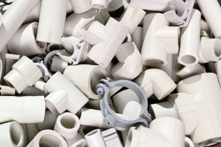 Parts of plastic piping and fitting as plumbing background.