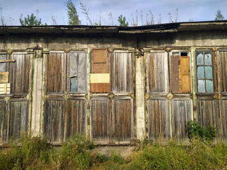 Wooden doors of old two-storey warehouse