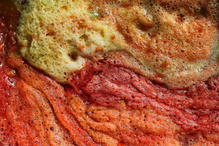 Frothy tomato juice, disgusting food concept background Standard-Bild