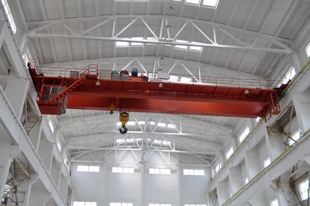 overhead crane: Tower crane in the factory workshop Stock Photo