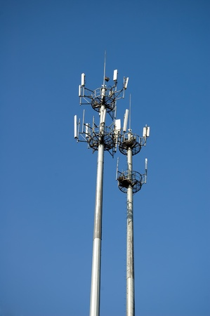 Low angle view of signal towers