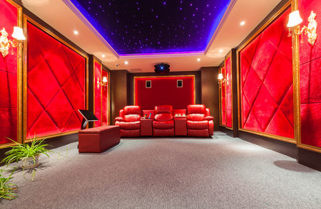 view of an elegant red couch: Theater room Editorial
