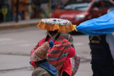 Peruvian city, Puno, Indian lady walking on the street Banco de Imagens