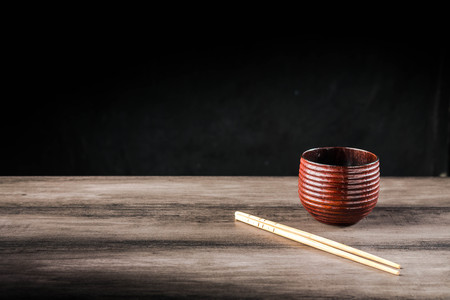 Wooden tea cup and chopsticks on the table Standard-Bild - 101495269