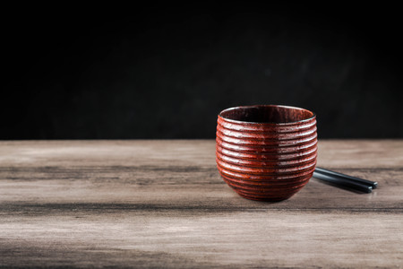 Wooden tea cup and chopsticks on the table Standard-Bild