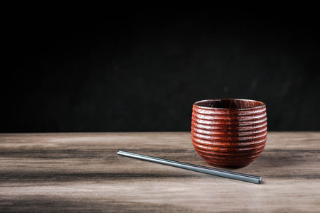 Wooden tea cup and chopsticks on the table Standard-Bild - 101475986