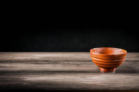 Wooden bowl on the table
