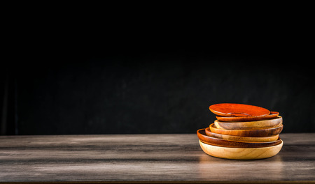 Wooden plates stacked on the table Standard-Bild