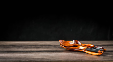 Wooden spoons on the table Standard-Bild