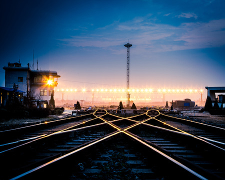 Cargo train platform at sunset with container Stock Photo