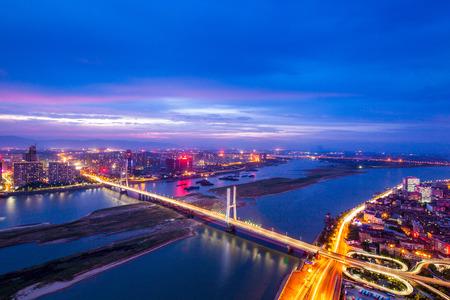 night view of the bridge and city in shanghai china. photo