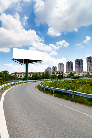 the billboard and road outdoor. photo