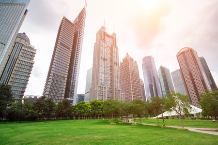 city park with modern building background in shanghai photo