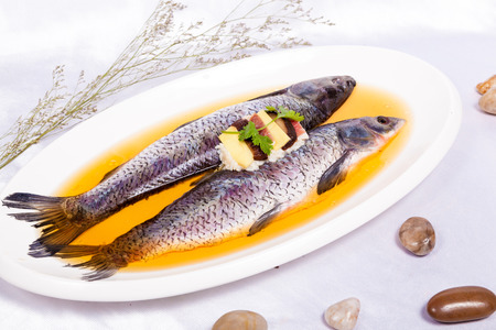 Baked crucian on a pillow from lentil and peas photo