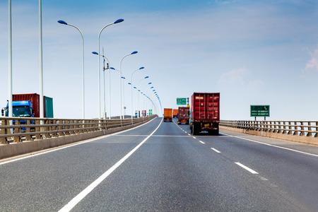 container truck on the cross-sea bridge in shanghai photo